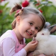 a kid smiling with pet